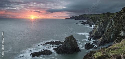 Poster Gris Sunrise over Bull Point landscape in Devon England