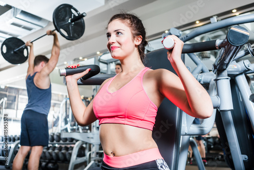plakat Woman and man having sport training in fitness gym