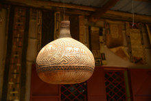Carved Decorative African Water Gourd Hanging On Porch