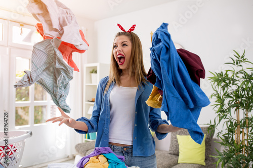 Fotografia, Obraz  Aggressive frustrated woman throws laundry in the air