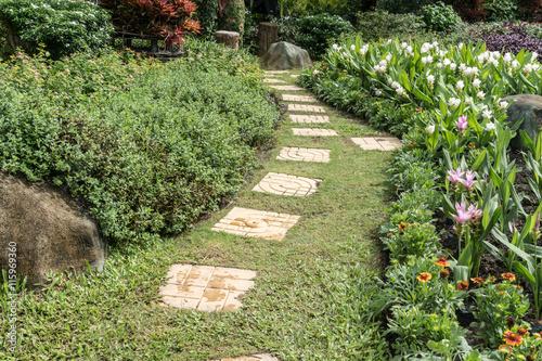 Staande foto Tuin Concrete Pathway in garden
