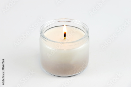 Fotografie, Obraz  candle flame fire of decorative candle on white background