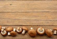 Champignon Mushrooms On Old Wooden Table. Top View.