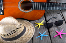 Summer Background Beach Bar Acoustic Guitar Star Hat And Starfish On A Grunge Wood