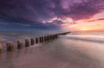 Obraz Wooden breakwater - Baltic seascape at sunset, Poland