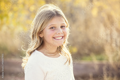 Beautiful Portrait of smiling little girl outdoors Canvas-taulu