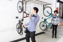 People Hang Bicycle On Wall Office Diverse Mix Race