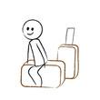 Person sitzt auf Koffer