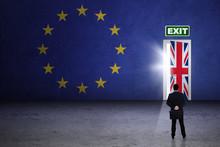 Businessman Looking At Brexit Door