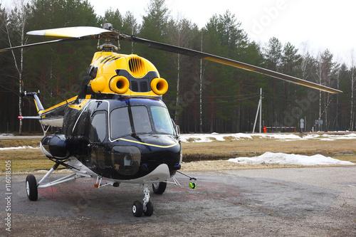 fototapeta na szkło Aircraft - Black-yellow helicopter