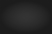 Abstract Wallpaper Or Backdrop In Dark Colors With Repeating Very Small Pattern Texture. Seamless Pattern That Looks Like Carbon Texture Consist Of Very Small Circlers Or Dots With Strong Vignette.