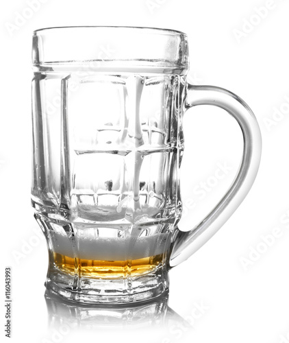 Fényképezés  Almost empty beer glass, isolated on white