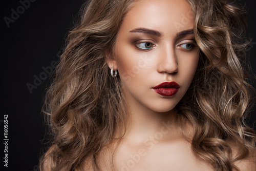 Fotografie, Obraz  Beautiful girl with long wavy hair . Blonde with curly hairstyle