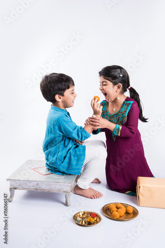Fotografering  indian small brother and sister enjoying and celebrating Raksha Bandhan festival