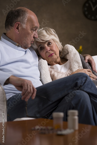 Fototapety, obrazy: Comforting his wife who is having her miserable days
