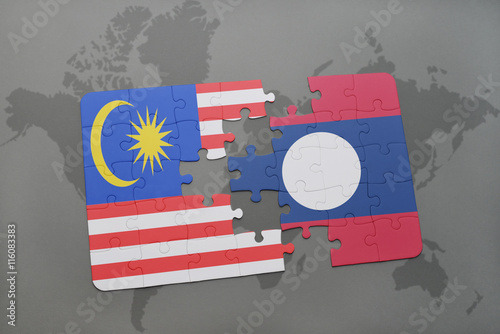puzzle with the national flag of malaysia and laos on a world map background Poster