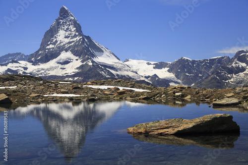Poster Reflexion Matterhorn reflected into alpine lake, Switzerland