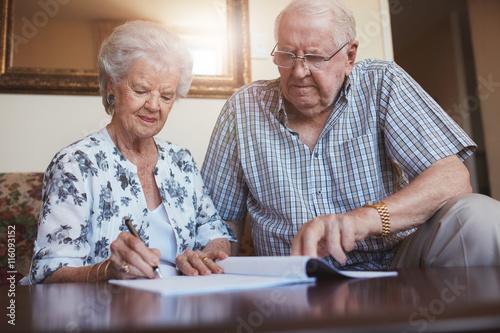 Fototapeta  Senior couple doing retirement paperwork