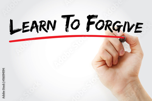 Fotografía  Hand writing Learn To Forgive with marker, concept background