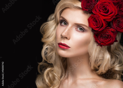 Poster  Beautiful blond girl in dress and hat with roses, classic makeup, curls, red lips