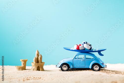Fotografie, Obraz  Miniature blue car with surfboard