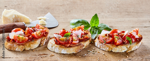 Fotografiet  Italian bruschetta with parmigiana cheese