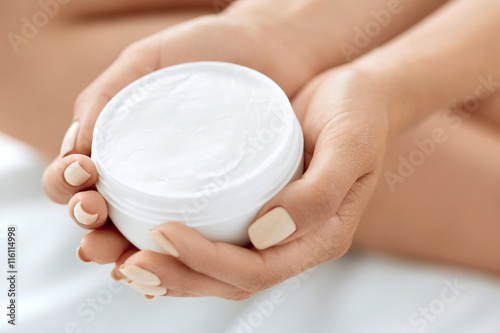 Fotografie, Obraz  Skin Care Product. Woman's Hands Holding Beauty Cream, Lotion.
