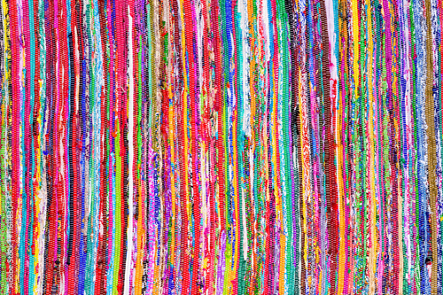 Close up colorful hand woven rug background Плакат