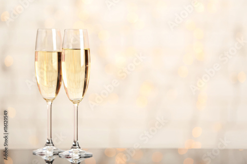 Fényképezés Two champagne glasses on light background