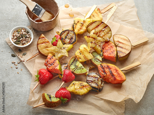 In de dag Grill / Barbecue grilled fruit pieces on wooden skewers