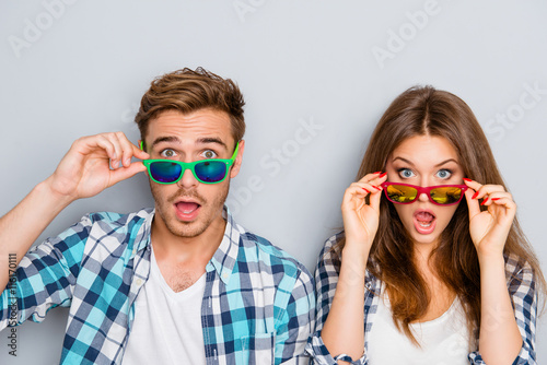 Fotografie, Tablou  Wow! Surprised man and woman in glasses with open mouth
