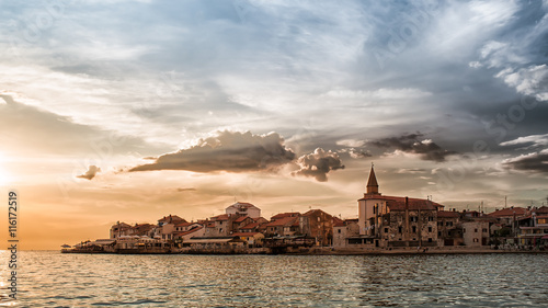 Foto op Plexiglas Kust The coast and the promontory of Umag Croatia at sunset with stormy sky
