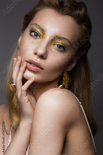 Poster  Beautiful girl in Underwear with creative gold makeup and hair