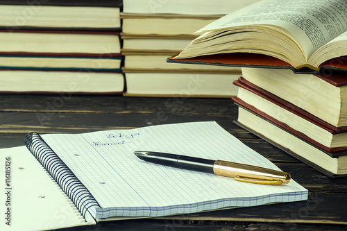 Books and exercise book with pen - Buy this stock photo and
