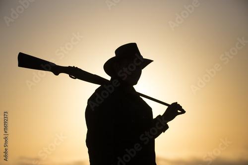 Fotografía  Ranger Silhouette orange Background