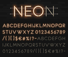 Realistic Neon Alphabet On A B...