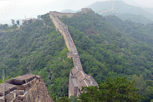 Papiers peints Muraille de Chine Great Wall of China atop the mountains in the forest, showing air pollution and smog, China
