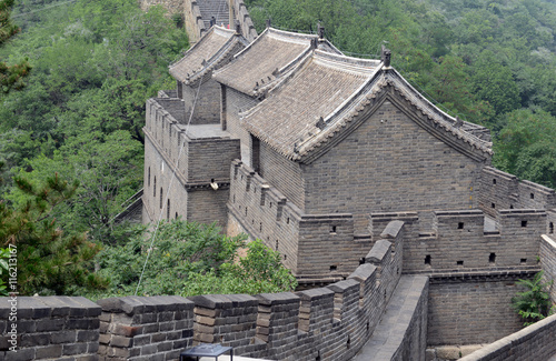 Great Wall of China atop the mountains in the forest, showing air pollution and Fototapeta