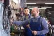 men working at carshop
