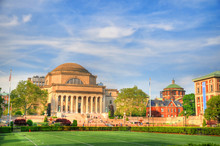 Colorful HDR Image Of Students And Faculty Members Walking Near The Famous Library At The Columbia University, New York City On A Summer Day