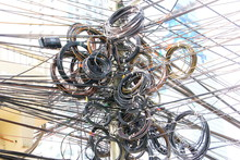 Choas, Messy, Tangle Of Electric Cable Post In Thailand