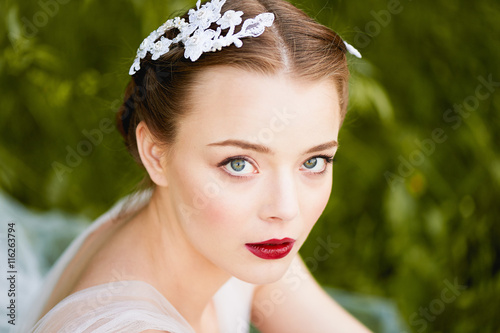 Fotografie, Obraz  Close-up portrait of girl with green eyes with a quality makeup