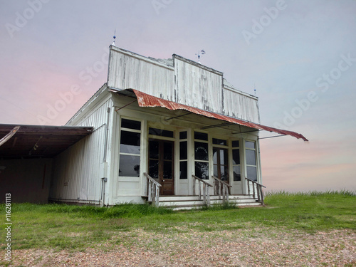 Tuinposter Stadion Vintage old abandoned western saloon storefront in disrepair