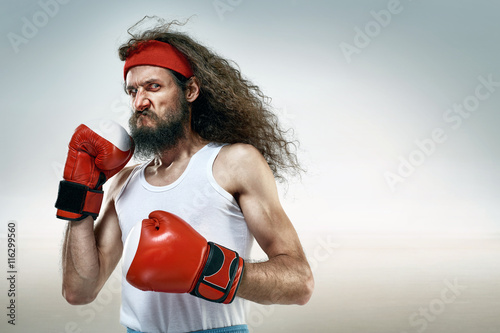 Plakat  Funny boxer wearing red boxing gloves