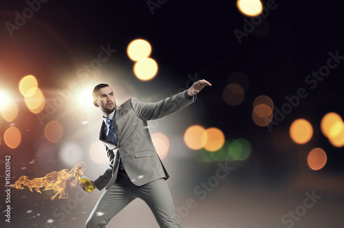 Businessman throwing petrol bomb . Mixed media Canvas Print