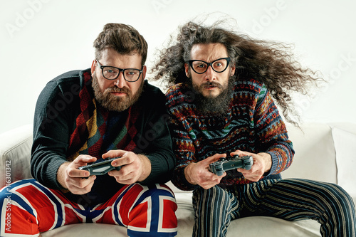 Plakat  Funny portrait of two best friends playing games