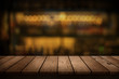 canvas print picture - wooden table with a view of blurred beverages bar backdrop