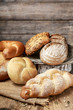 Breads and rolls on wood