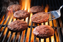 Beef Hamburger Patties Sizzling On The Barbecue