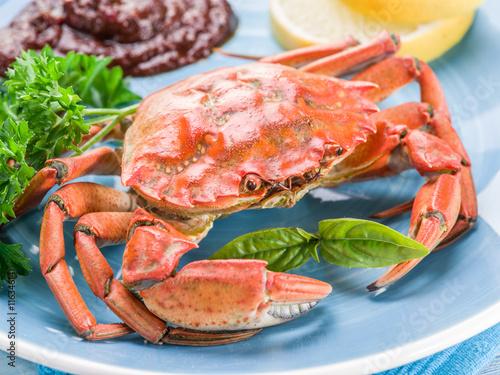 Fotobehang Schaaldieren Cooked crab with lemon and herbs.